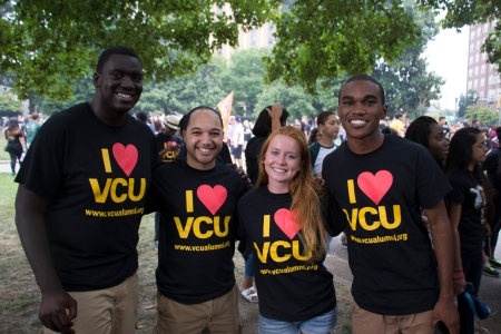 four students posed in their I Love VCU Alumni shirts