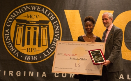 Angelique Scott receiving Student Affairs Award check