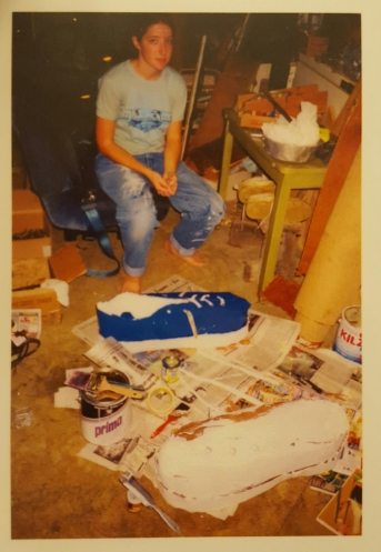 aged photo of a paper mache shoe being made