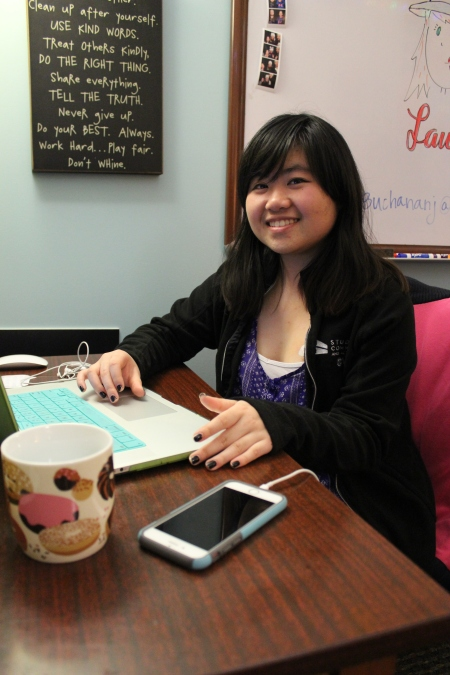 Rachel Chow designing on her laptop