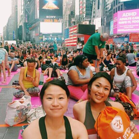 VCU students performing yoga in Times Square
