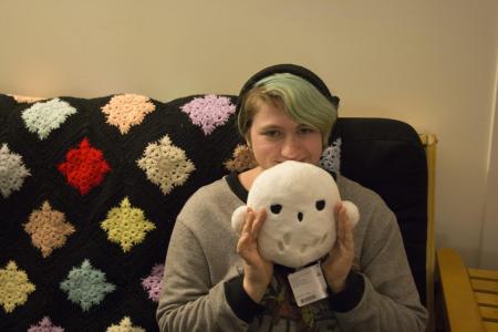 Amber Hooke holding her stuffed owl