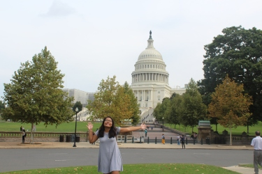 Student in front of the Capitol