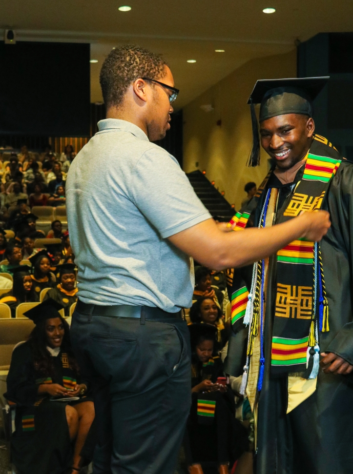 Graduate receives Donning of the Kente stole