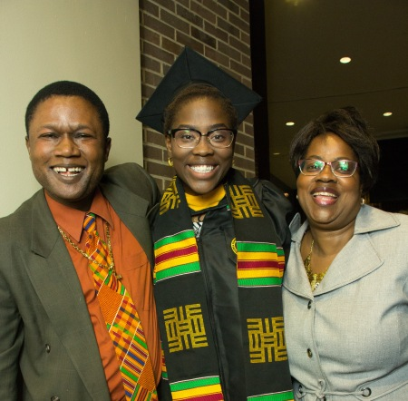 Graduate and guests posing at the Donning of the Kente Ceremony