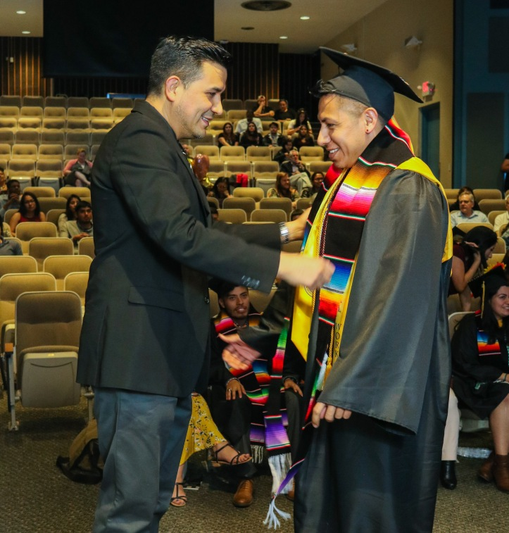 Graduate receives Latinx Achievement Ceremony commemorative stole